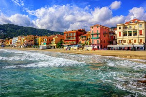 Mediterranean sand beach in traditional touristic town Alassio on italian Riviera by San Remo, Liguria, Italy